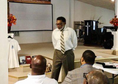 Man in white shirt and tie teaching