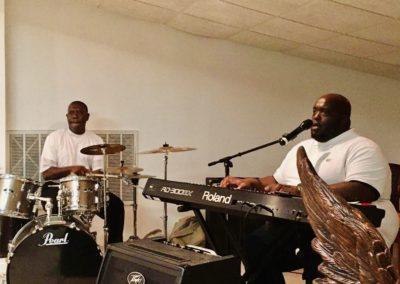 Worship men playing keyboard and drums